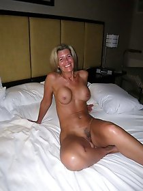Mature whore getting undressed on picture